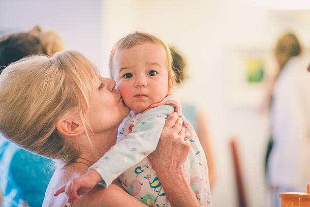 Cuddling a baby at wedding
