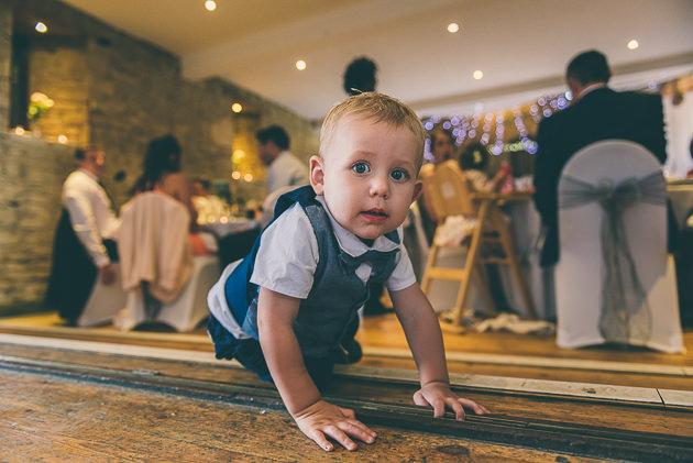 Baby crawling at wedding