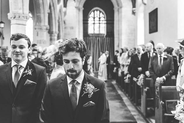 Groom wating for bride at Middle Barton Church
