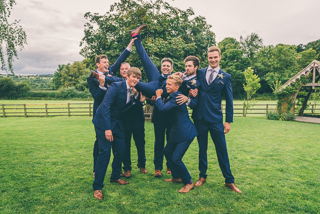 Groom lift at wedding in Stow on the Wold