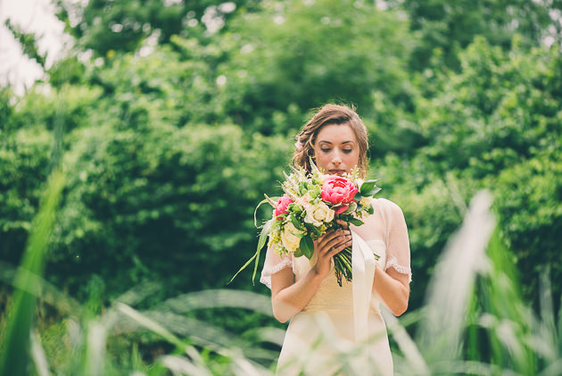 Holding a bouquet up against face