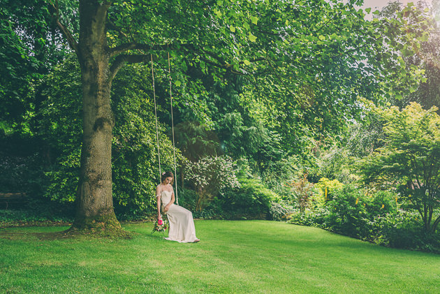 Bride swinging on rope swing