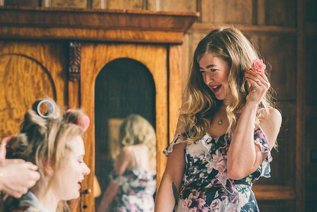 Bridesmaid talking to bride