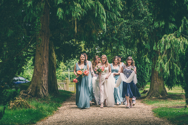Bride walking church pathway