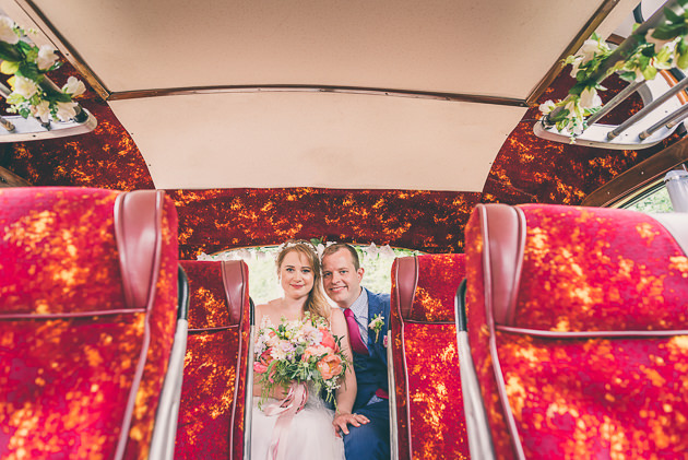 Bride and Groom on vintage bus