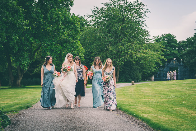 Bride and bridesmaids walking to Elmore Court