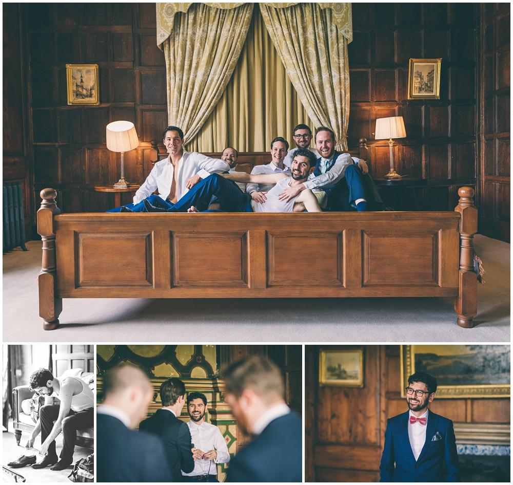Groom having fun with groomsmen in the Oak Room at Elmore Court